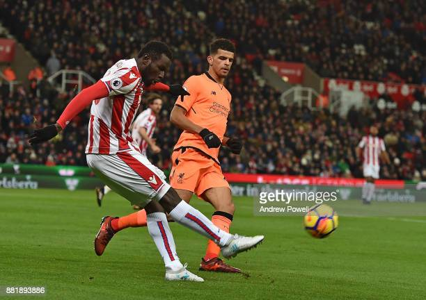 Solanke of Liverpool With Mame Diouf of Stoke during the Premier League match between Stoke City and Liverpool at Bet365 Stadium on November 29 2017...