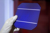 Solar cells wafers being made at a factory The proccess involved laying a circuit on an selected and optimized wafer of monocrystalline or...