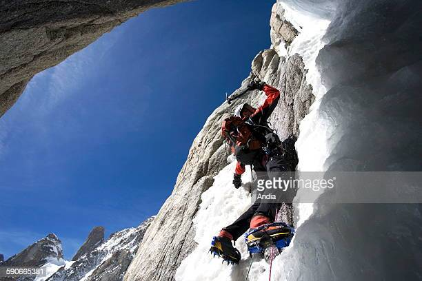 M6 Solar chute Pointe Lachenal south face of the Mont Blanc man climbing up a rock face with his ice axe