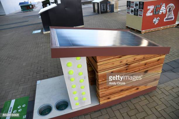 A solar dog house designed by AECOM on display for the Sustainable BARKitecture Dog House Competition at Denver International Airport September 20...