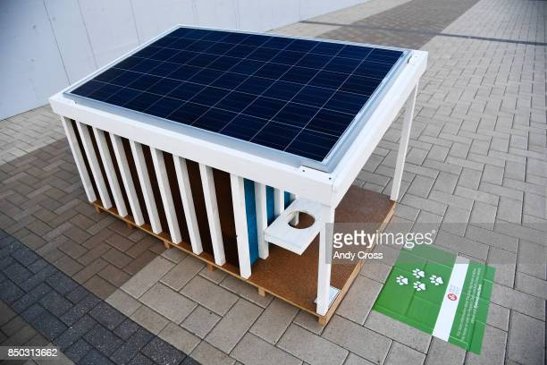 A solar dog house designed by Barker Rinker Seacat Architecture on display for the Sustainable BARKitecture Dog House Competition at Denver...