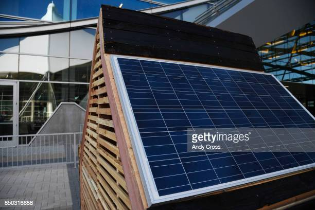 A solar dog house designed by BurkettEUA on display for the Sustainable BARKitecture Dog House Competition at Denver International Airport September...