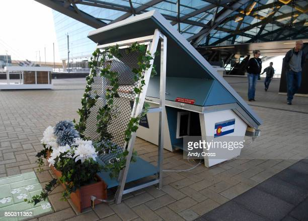 A solar dog house designed by Burns McDonnell features a rain water collection system to not only supply water to the dog bowl but also to water...