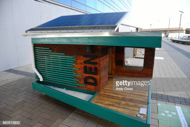 A solar dog house designed by CooverClark on display for the Sustainable BARKitecture Dog House Competition at Denver International Airport September...