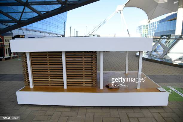 A solar dog house designed by Jacobs on display for the Sustainable BARKitecture Dog House Competition at Denver International Airport September 20...