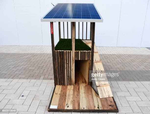 A solar dog house designed by Oz Architecture on display for the Sustainable BARKitecture Dog House Competition at Denver International Airport...