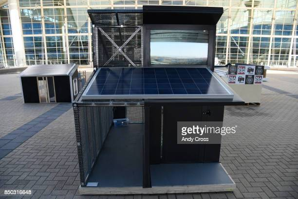 A solar dog house designed by RMH Group on display for the Sustainable BARKitecture Dog House Competition at Denver International Airport September...
