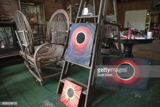 Solar eclipse atwork by John Donovan is offered for sale in an artisan's shop on August 18 2017 in Makanda Illinois With approximately 2 minutes 40...