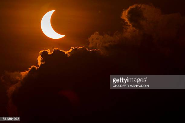 TOPSHOT A solar eclipse is pictured from Banda Aceh on March 9 2016 A total solar eclipse swept across the vast Indonesian archipelago on March 9...