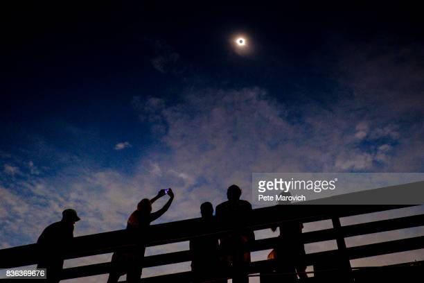 Solar eclipse watchers were ecstatic as the clouds broke minutes before totality during the total solar eclipse from the one of last vantage points...