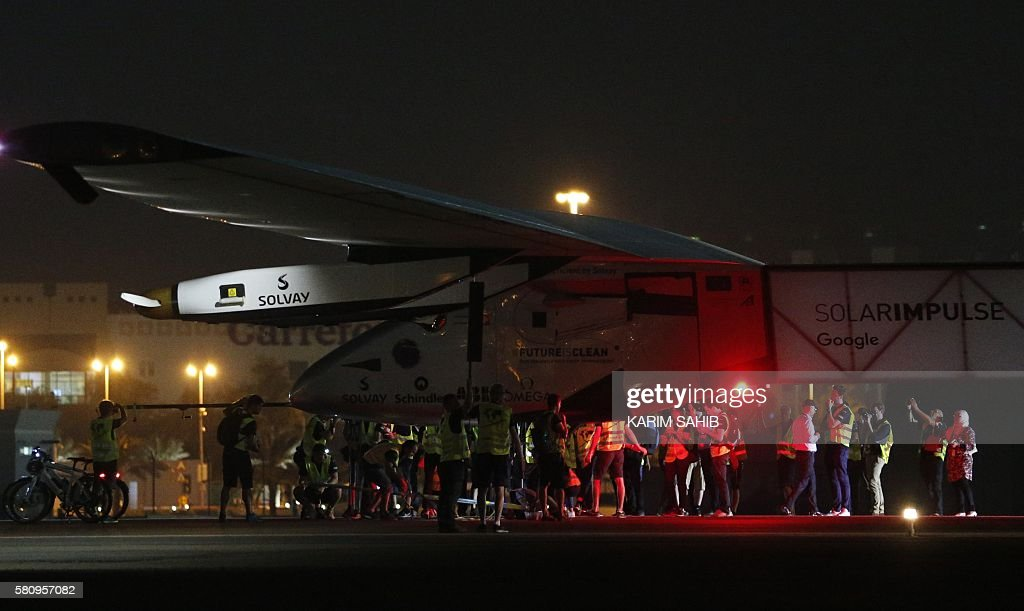 TOPSHOT Solar Impulse 2 the solar powered plane arrives at Al Batin Airport in Abu Dabi to complete its world tour flight on July 26 2016 in the...