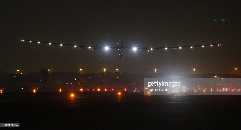Solar Impulse 2 the solar powered plane arrives at Al Batin Airport in Abu Dabi to complete its world tour flight on July 26 2016 in the United Arab...