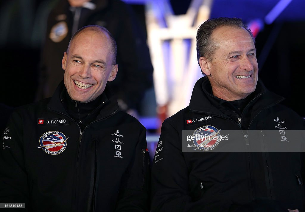 Solar Impulse Chairman and pilot <a gi-track='captionPersonalityLinkClicked' href=/galleries/search?phrase=Bertrand+Piccard&family=editorial&specificpeople=773279 ng-click='$event.stopPropagation()'>Bertrand Piccard</a> (L) smiles with Solar Impulse CEO and pilot Andre Borschberg (R) during a news conference at Moffett Field on March 28, 2013 in Mountain View, California. The Solar Impulse, a solor powered plane that has already made international and intercontinental flights in Europe and Africa, will begin test flights around the San Francisco Bay Area ahead of a planned flight across the United States later this year.