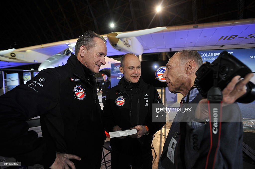 Solar Impulse founders and pilots Bertrand Piccard (C) and Andre Borschberg (L) answer questions at a press conference at the NASA Ames Research Center in Mountain View, California on Thursday, March 28, 2013.The Solar Impulse project aims to fly an aircraft around the world using only solar energy. AFP PHOTO/Josh Edelson