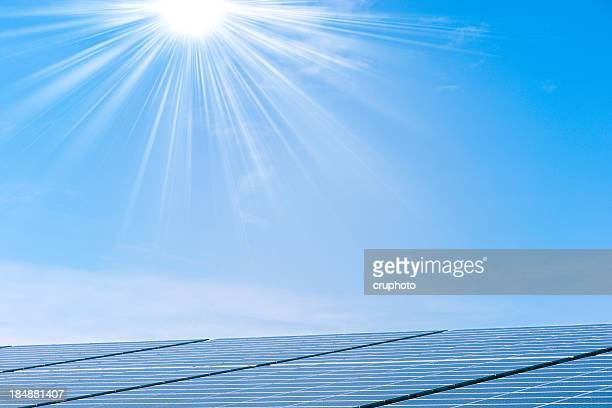 Solar panels against a sunny sky with many copyspace