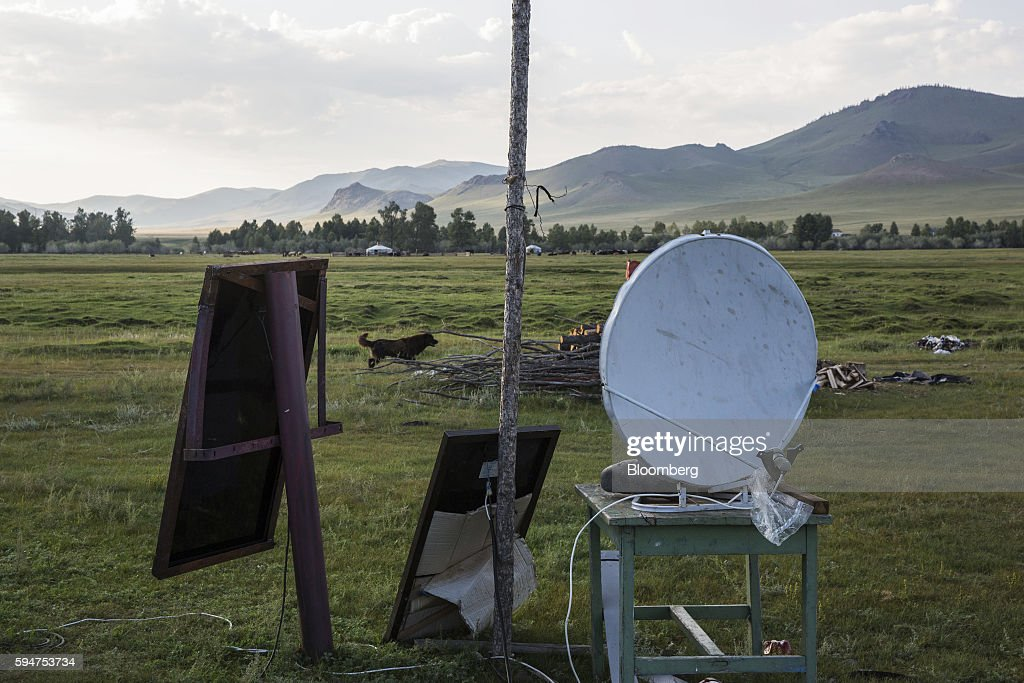 Solar panels and a satellite dish sit outside a home in Ikh Tamir Mongolia on Tuesday Aug 2 2016 Mongolia a mineralrich and landlocked $12 billion...