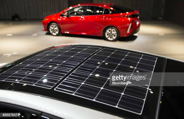 Solar panels are seen on the roof of Toyota Motor Corp's new Prius plugin hybrid vehicles known as Prius Prime in the US at its sales launch at the...