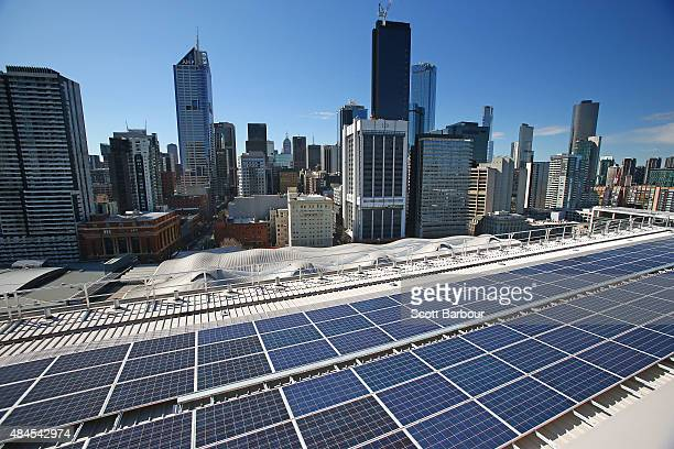 Solar panels are seen on the rooftop at AGL's new Docklands office on August 20 2015 in Melbourne Australia The rooftop solar system covers 20000...