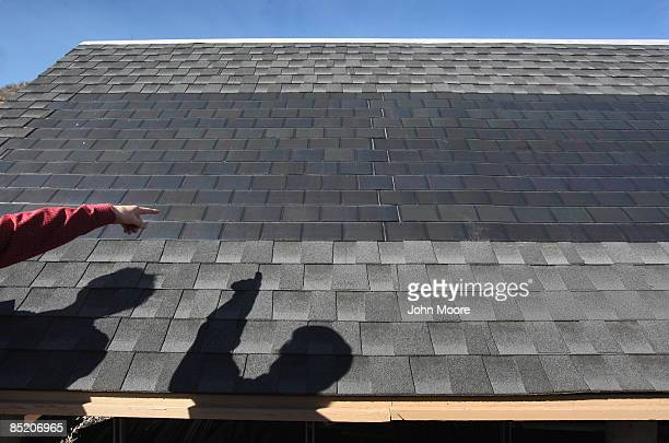 Solar panels attached to roof shingles create energy while being tested at the National Renewable Energy Laboratory March 3 2009 in Golden Colorado...