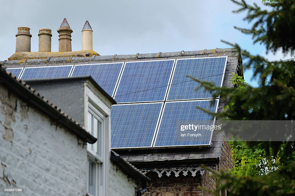 Solar panels can be seen attached to a property in the village of Kirby Misperton in North Yorkshire near the site of the KM8 fracking site on May 24, 2016 in Malton, England. North Yorkshire's Planning and Regulatory Committee voted seven to four in favour of a planning application submitted by Third Energy to carry out fracking at the KM8 site. Hydraulic fracturing, or fracking, is a technique designed to recover gas and oil from shale rock.