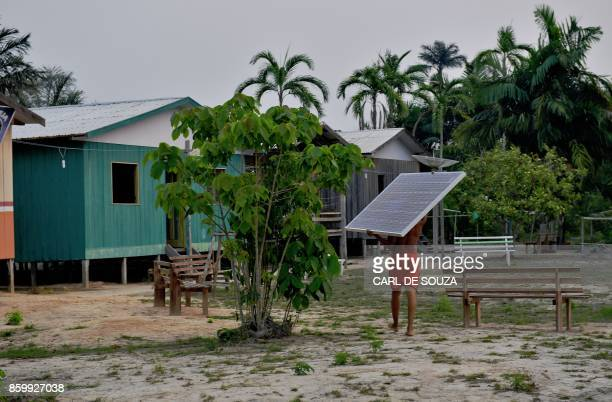 Solar panels donated by the World Wildlife Fund and Brazilian government are carried to the village of Volta do Bucho in the Western Amazon region on...