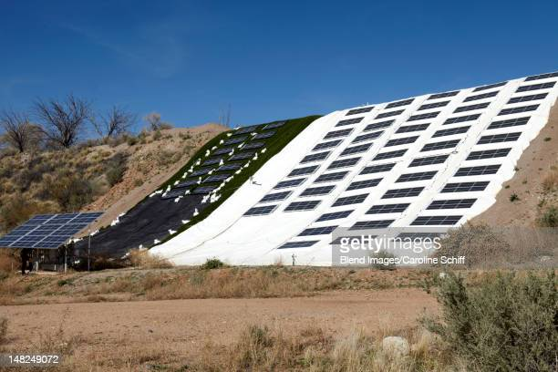 Solar panels draped over hillside