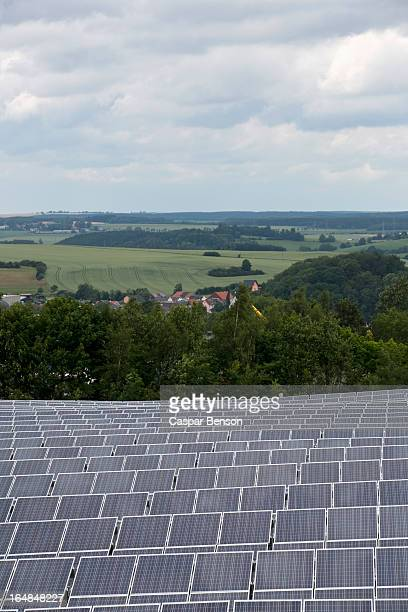 Solar panels in front of natural landscape