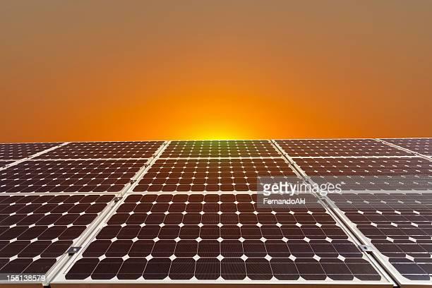 Solar panels on a beautiful sunrise