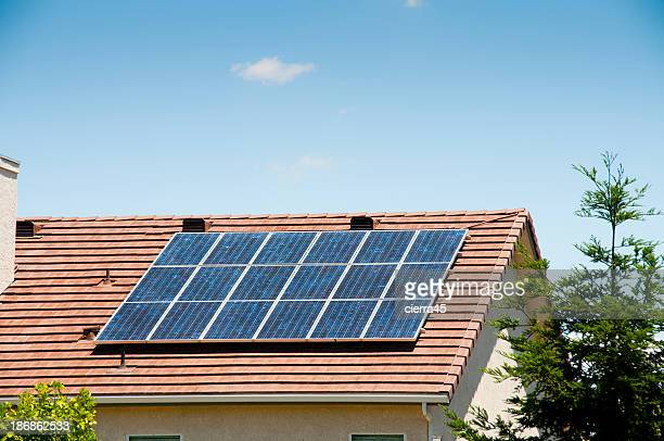 Solar panels on a house rooftop