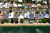 Solar panels on suburban waterfront homes, Australia