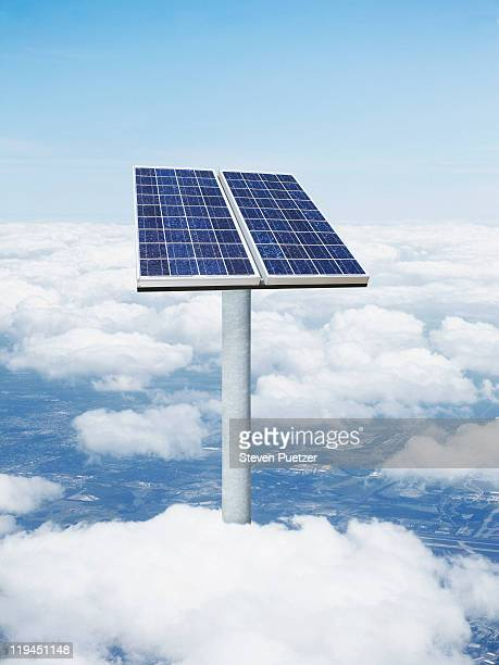 Solar panels rising above the clouds