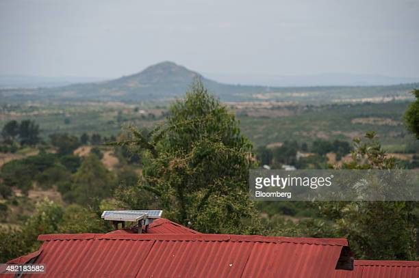Solar panels sit on the roof of a home powered by MKopa solar technology in Ndela village Machakos county in Kenya on Wednesday July 22 2015...