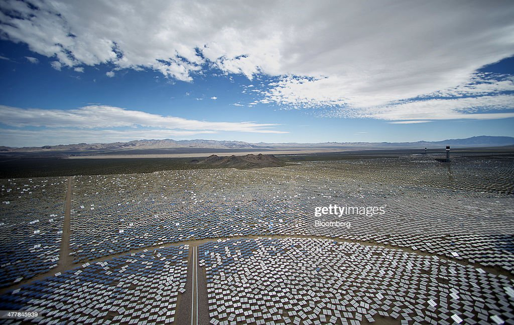 Solar panels stand at the Ivanpah Solar Electric Generating System in the Mojave Desert near Primm, Nevada, U.S., on Monday, March 10, 2014. The 392-megawatt California Ivanpah plant developed by Google, NRG and Bright Source, which began operating in February, brings utility-scale solar to more than 5.5 gigawatts, up 1,089% since 2010. Photographer: Jacob Kepler/Bloomberg via Getty Images