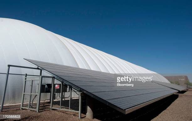 Solar panels stand next to the Arizona State University Verde Dickey Dome in Tempe Arizona US on Tuesday June 11 2013 Solar installations in the...
