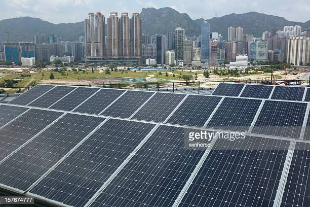 Solar Panels with a modern city background