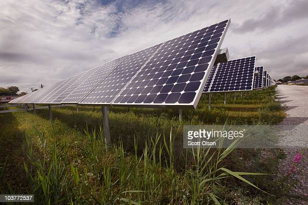 Solar photovoltaic panels generate electricity at an Exelon solar power facility on September 1 2010 in Chicago Illinois The 10megawatt facility...