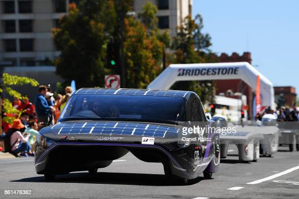 Solar Racing Team vehicle 'Sunswift Violet' from Australia competes during a street parade for the 2017 Bridgestone World Solar Challenge down...