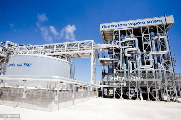 A solar steam generator and the melt salt tank are seen at Enel SpA's combined cycle thermodynamic solar power plant at its inauguration in Priolo...