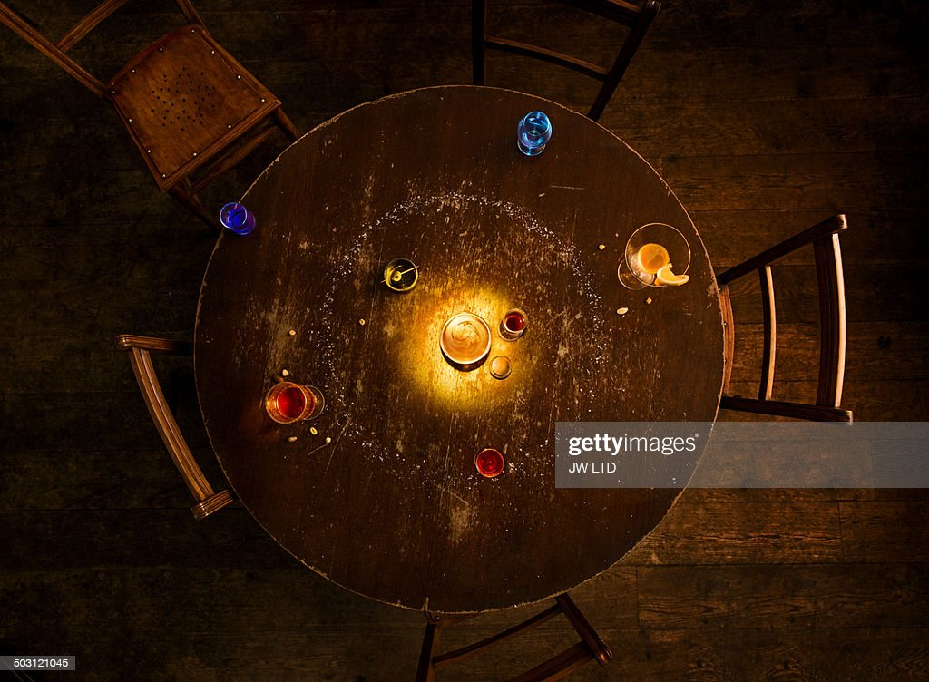 solar system model on round pub table, made from glasses of beer and spirits ,studio set build.