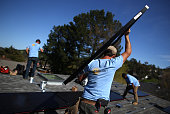 SolarCraft worker Joel Overly carries a solar panel on the roof of a home on February 26 2015 in San Rafael California According to a survey report...