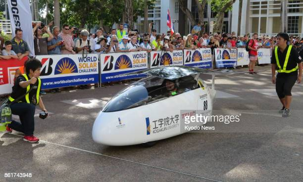 A solarpowered car developed by Kogakuin University in Tokyo stands at the start in Darwin on Oct 8 2017 of the World Solar Challenge a 3000kilometer...