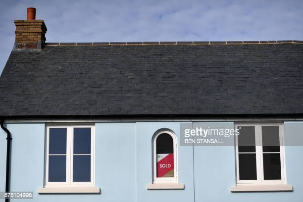 A 'sold' poster is seen in the window of a house in Nansledan housing development championed by Britain's Prince Charles Prince of Wales at Newquay...