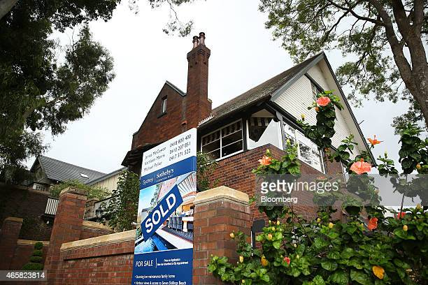 A 'sold' sign for a residential property listed by Sotheby's International Realty stands outside a house in the suburb of Point Piper in Sydney...