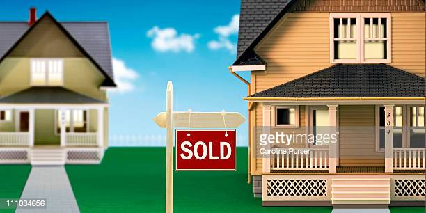 Sold sign in front of model houses