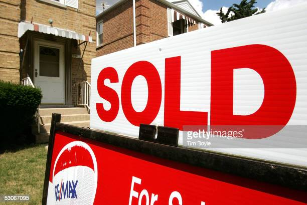 A 'Sold' sign in seen in front of a home June 14 2005 in Chicago Illinois Unusually low mortgage rates of late have caused a recent boom in the...
