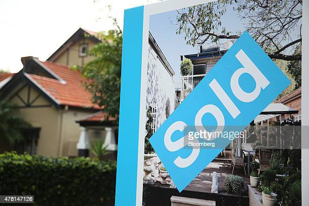 A 'Sold' sign is displayed outside a house in the suburb of Balmain in Sydney Australia on Thursday June 18 2015 Surging home prices in cities...
