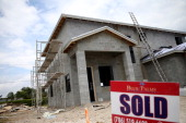 A sold sign is seen in front of a new single family home on April 16 2014 in Miami Florida Housing starts grew at an annual rate of 946000 last month...