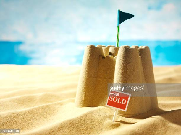 Sold Sign, Sea and a Sandcastle