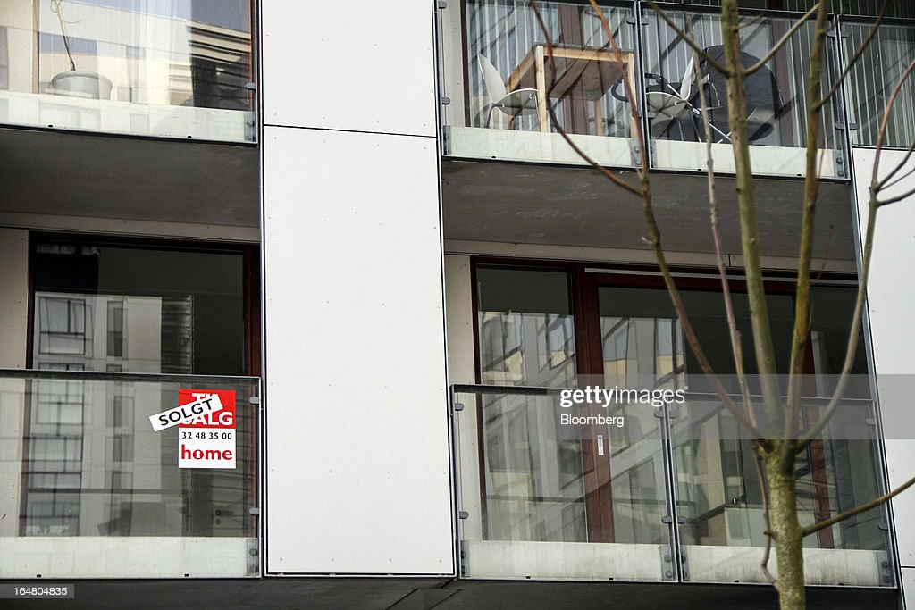 A 'Sold' sign sits in the window of a residential apartment in Orestad on the outskirts of Copenhagen, Denmark, on Thursday, March 28, 2013. Denmark's government rejected a plan by mortgage banks last week to split troubled loans and extend interest-only terms for amounts below an 80 percent loan-to-value limit. Photographer: Freya Ingrid Morales/Bloomberg via Getty Images