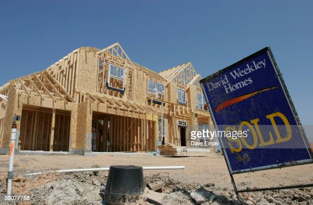 A sold sign sits near a home site in the Magnolia Creek subdivision June 16 2005 in League City Texas The US Commerce Department announced on June 16...
